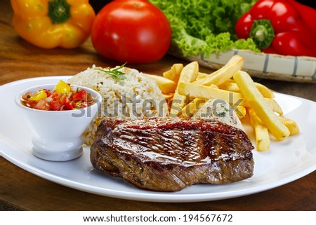 Picanha roast potatoes and vegetables with rice - stock photo