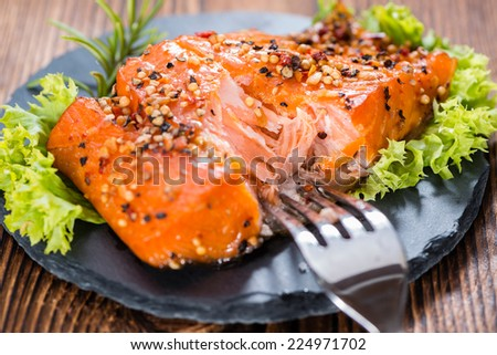 Pice of Smoked Salmon marinated with spices and fresh herbs