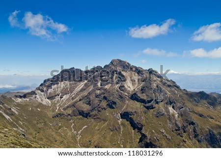 Pichincha volcano in nearby of Quito, Ecuador with blue skyes - stock photo