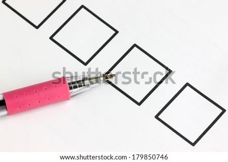Pick Pen point to check box on white background. - stock photo