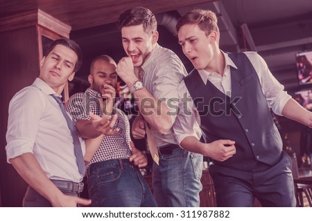 Pick the best of friends. Four men shout and rejoice meeting. Friends having fun together - stock photo