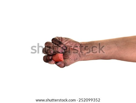 Pick up food with dirty hands, His hands are dirty with dirt lodged in the nails,(concept for pathogens/ bacteria under nails) - stock photo