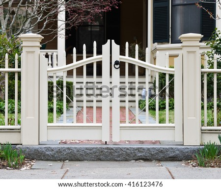 Picket wooden gate and fence - stock photo