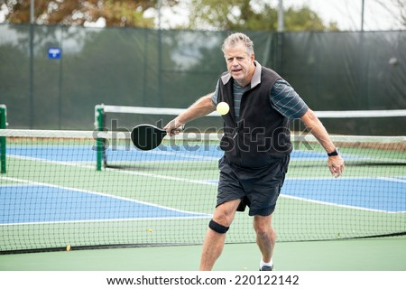 Pickleball player on the court, toned image - stock photo