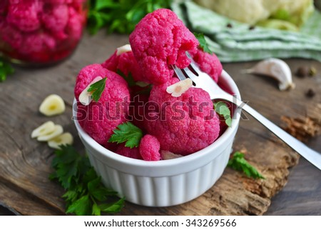 Pickled cauliflower with beetroot - stock photo
