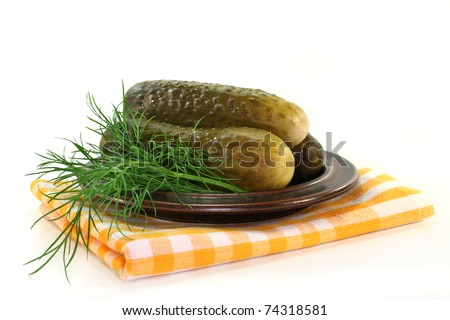 Pickled cucumber and dill on a plate - stock photo