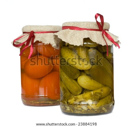 pickled cucumber and tomato in glass - stock photo