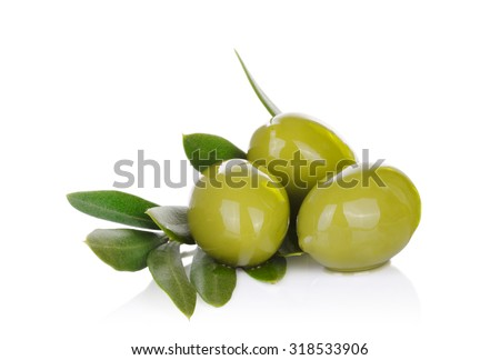 Pickled green olives and olive tree branch on a white background. - stock photo