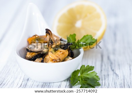 Pickled Mussels (with fresh herbs) as detailed close-up shot - stock photo