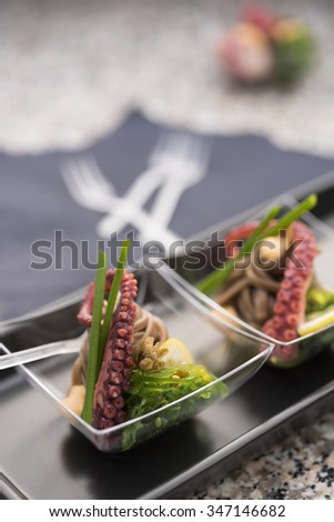 Pickled octopus with spicy wakaba - stock photo