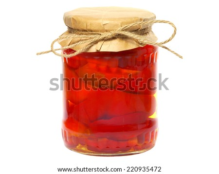 Pickled red sweet peppers in a glass jar - stock photo