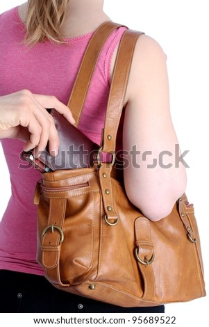 Pickpocketing a wallet out of a handbag of a woman - stock photo