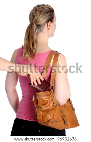 Pickpocketing wallet out of handbag - stock photo