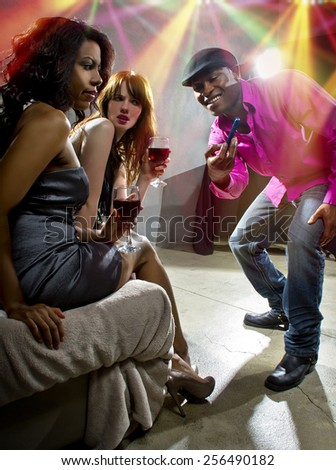 pickup artists harrassing women at a nightclub