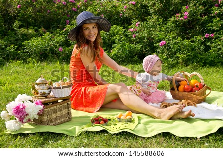 Picnic, a young mother with her daughter resting - stock photo