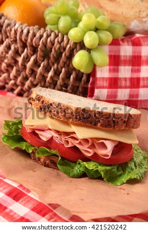 Picnic basket ham and cheese sandwich - stock photo