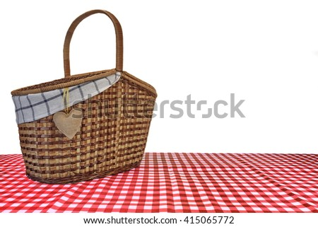Picnic Basket On The Red Checkered Tablecloth Isolated On White Background - stock photo