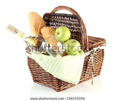 Picnic basket with apples and bottle of wine, isolated on white - stock photo