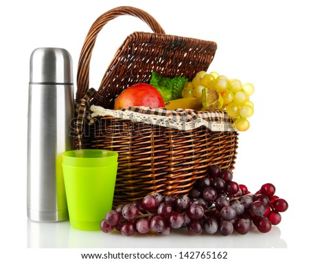 Picnic basket with fruit and thermos isolated on white - stock photo
