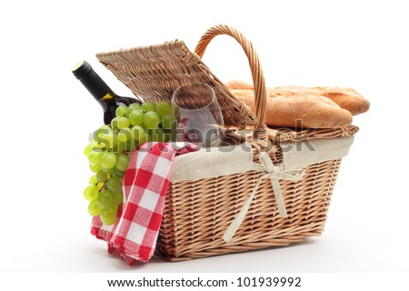 picnic basket with fruit bread and wine. - stock photo