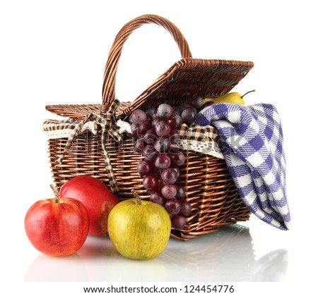Picnic basket with fruits and blanket isolated on white - stock photo