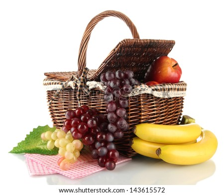 Picnic basket with fruits isolated on white - stock photo