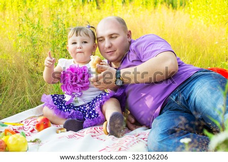 Picnic, father and daughter on nature - stock photo