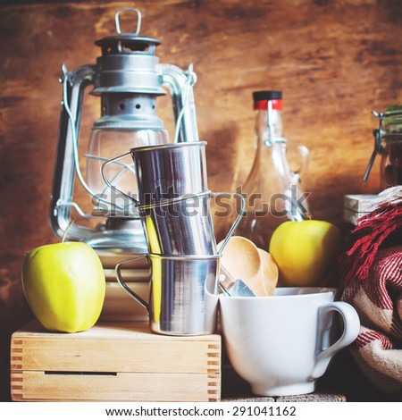 Picnic Set with Vintage objects, Dishes, Fruits, Lamp.Toned image - stock photo