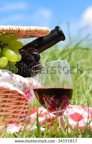 picnic setting with wine and grapes