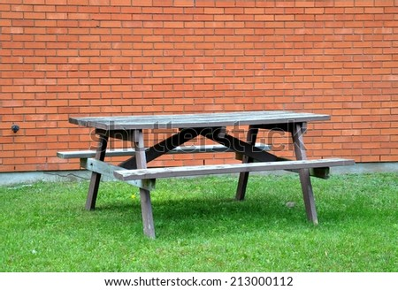 Picnic table in a yard - stock photo