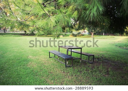 Picnic table in beautiful park - stock photo