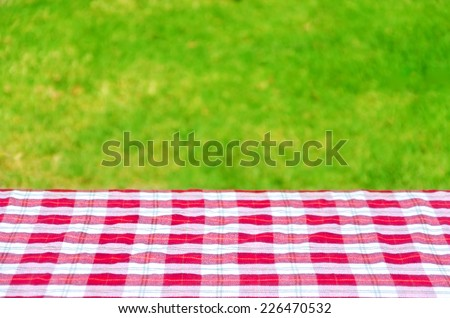 Picnic tablecloth textile on the table background - stock photo