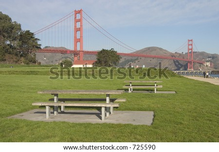 Picnic tables await family and food in a park near San Francisco's Golden Gate. - stock photo