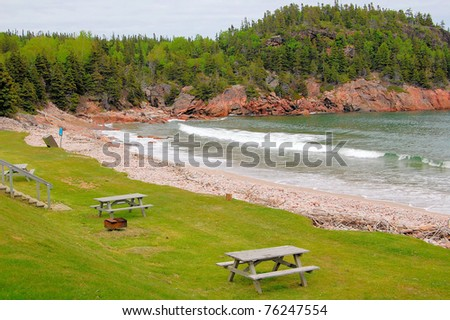 Picnic Tables in a Secluded Beach and Cloudy Sky