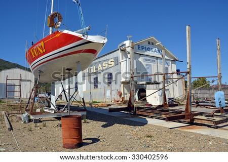 Picton, New Zealand - October 09, 2015: Yacht being repaired at a Shipyard in Waikawa Marina, Picton, New Zealand. - stock photo