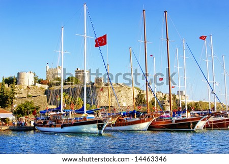 pictorial scene with yachts near castle (Bodrum - Turkey) - stock photo