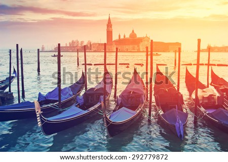 Pictorial view of blue gondolas in Venice, Italy. Color toning effect has been applied.  - stock photo