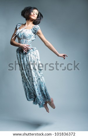 Picture a beautiful fairy flying girl in blue  dress - stock photo