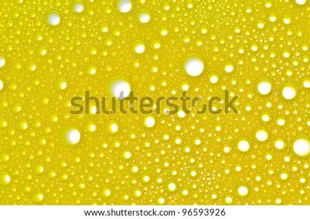 Picture a foam bubble yellow macro background. - stock photo