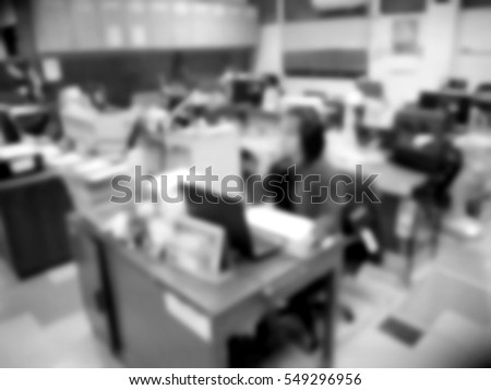 Picture blurred  for background abstract and can be illustration to article of businesspeople officer working computer in office