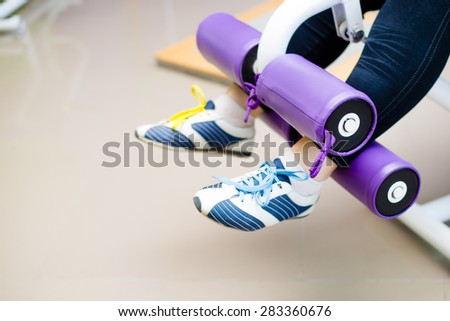 Picture closeup on legs of person doing fitness exercises - stock photo
