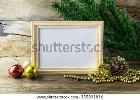 Picture Frame and Christmas decorations on old wooden background.  - stock photo
