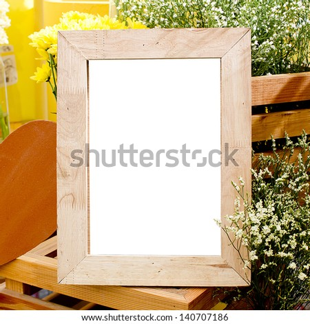 Picture frame and flowers on a dresser in a contemporary - stock photo