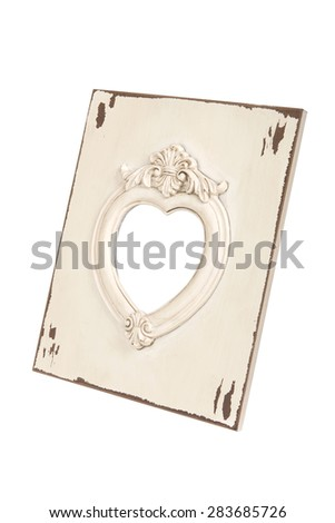 Picture frame in heart shape isolated with clipping path. - stock photo