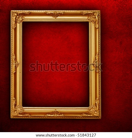 picture frame on red paint wall - stock photo
