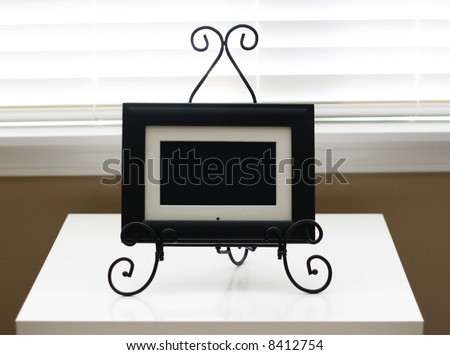 Picture frame on white table - stock photo