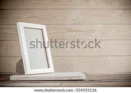 picture frame on wood table background - stock photo