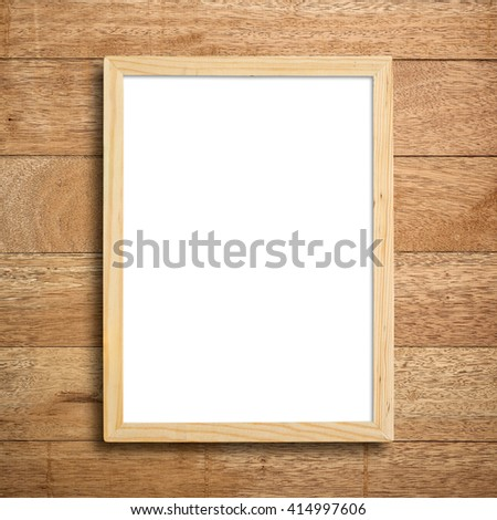 Picture frame on wood wall. - stock photo