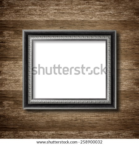 picture frame on wooden wall background - stock photo