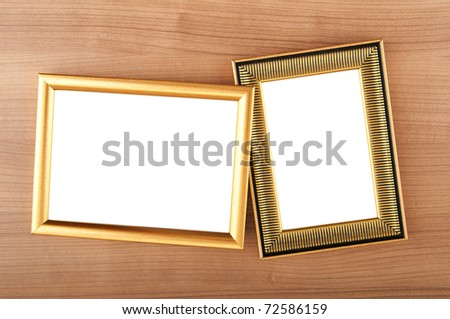 Picture frames on the polished wooden background - stock photo